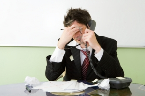 man-stressed-at-work_iStock_000006268299XSmall